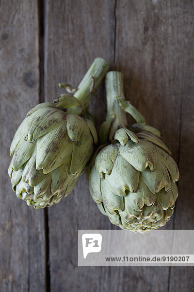 Directly above shot of artichokes on table