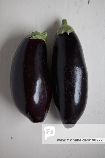 Close-up of eggplants on table