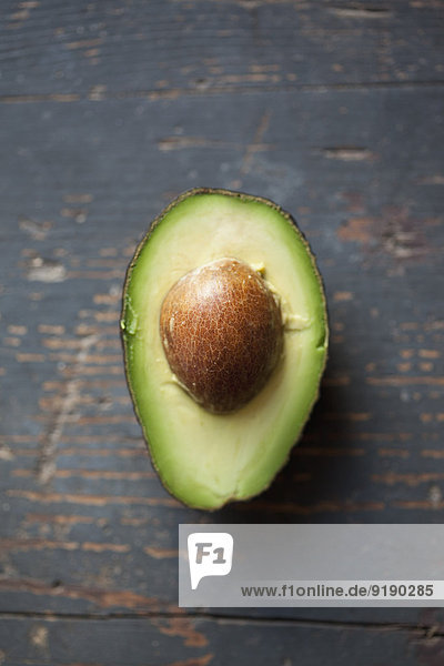 Close-up of avocado on wooden table