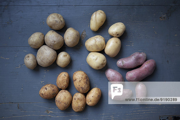 Directly above shot of various potatoes on wooden table