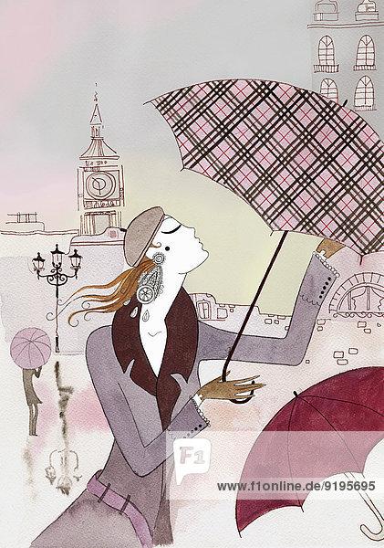 Schöne Frau kämpft im Wind mit ihrem Regenschirm