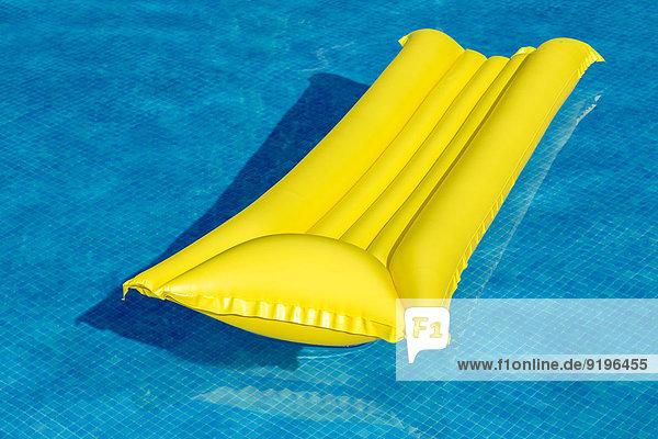 Yellow lilo  in a swimming pool
