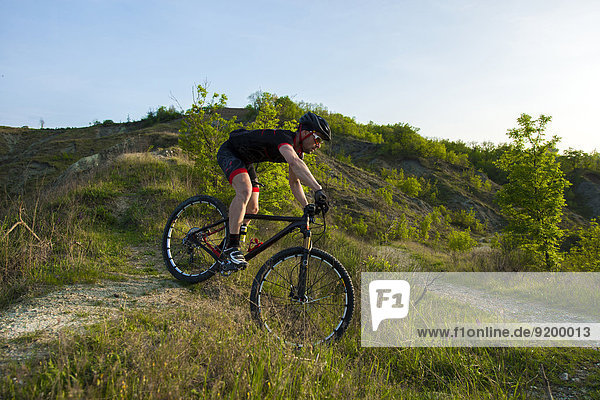 Man riding mountain bike in nature in the Bologna countryside  Italy