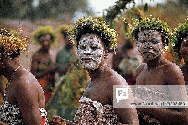Gabon  west africa  omboue village along the Fernan Vaz coast women made up for secret ceremony Djembe