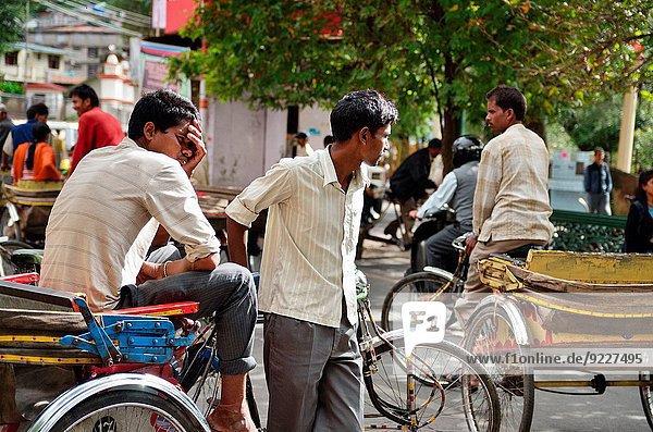 Cycle rickshaw drivers wait for customers in Nainital  India.