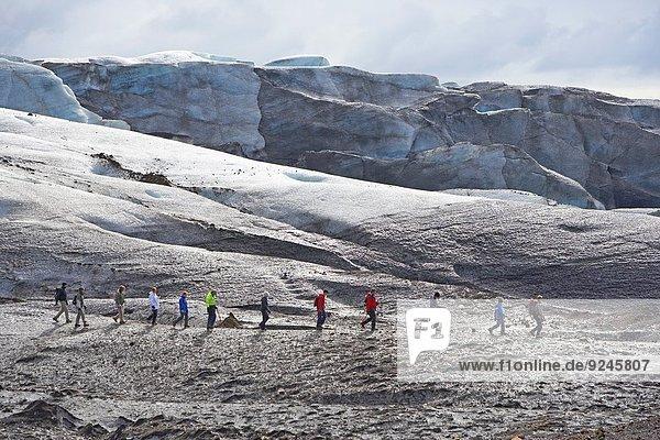 Exploring Svinafellsjokull Glacier  Iceland.
