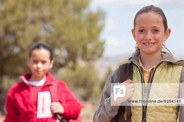 Portrait of two girls out hiking  Sedona  Arizona  USA