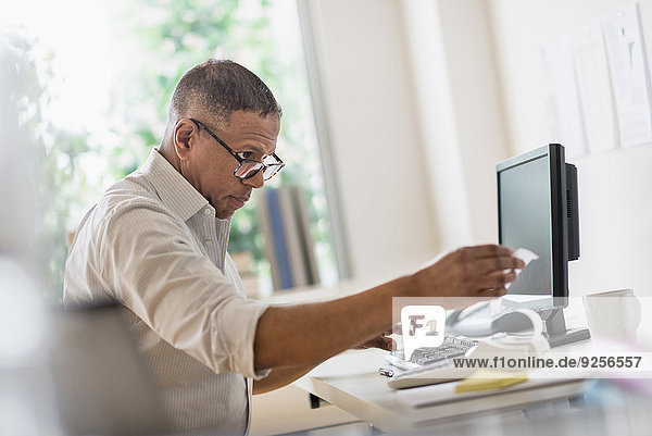 Mature man working in home office