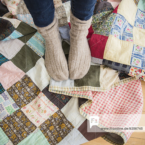 Elevated view of woman's legs wearing woolen socks