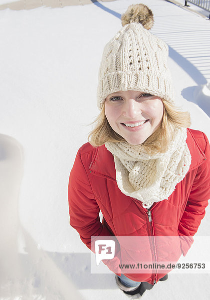 Portrait of young woman wearing knit hat in winter