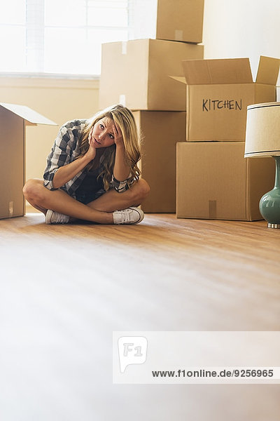 Young woman during moving into new house