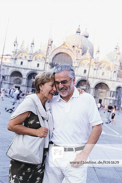 Senior couple hugging in St. Mark's Square  Venice  Veneto  Italy