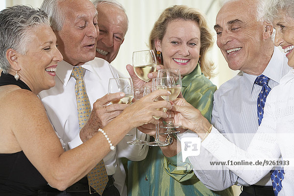 Senior friends toasting each other