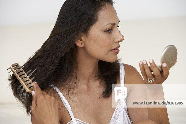 Indian woman brushing her hair