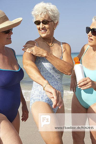Senior women walking on beach