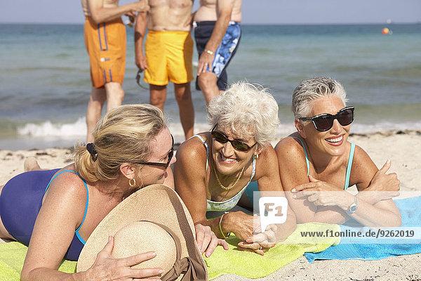 Senior women relaxing on beach