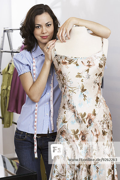 Caucasian dressmaker working in studio