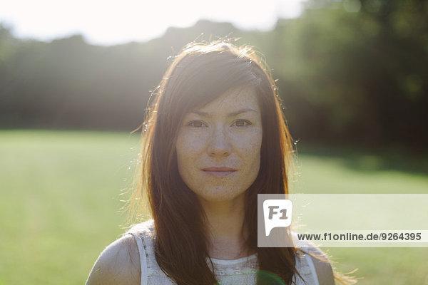 Portrait of brunette woman outdoors