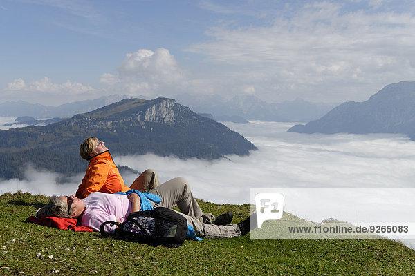 Austria  Tyrol  Chiemgau Alps  Hikers resting at Fellhorn mountain