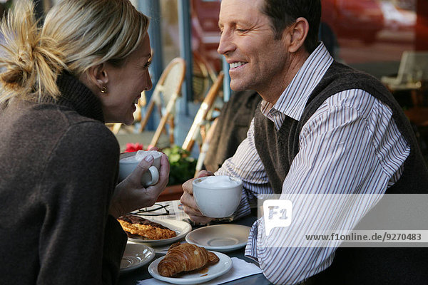 Mature couple at an outdoor cafe