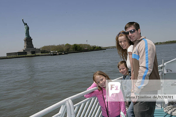 Family of four  Statue of Liberty