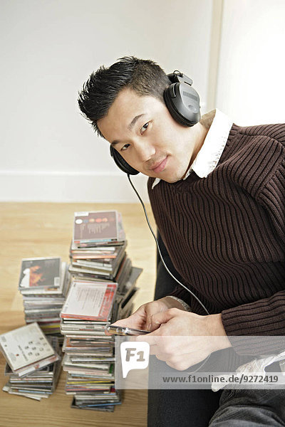 One young man listening music  portrait