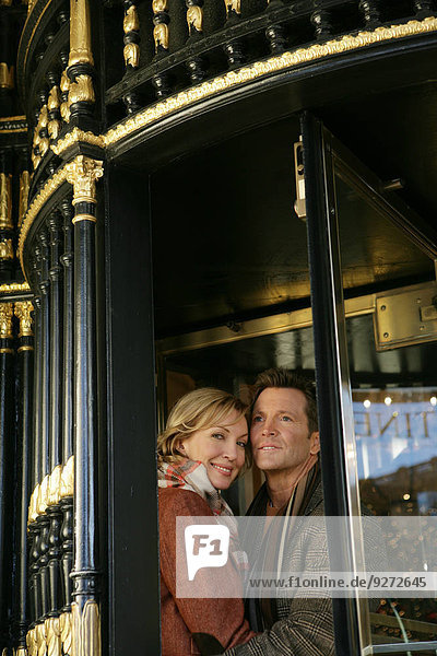 Mature couple in between revolving doors