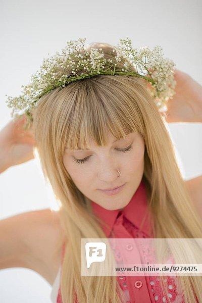 Portrait of woman wearing flower wreath