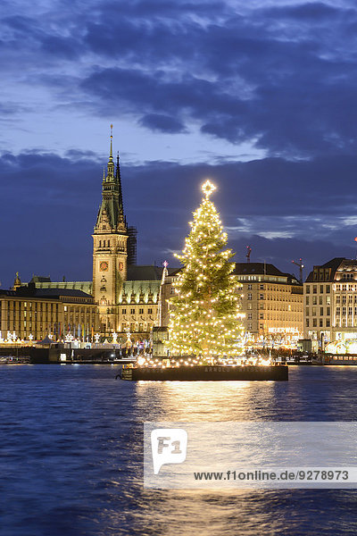 Binnenalster lake with Christmas tree and Town Hall at Christmas time  Hamburg  Germany