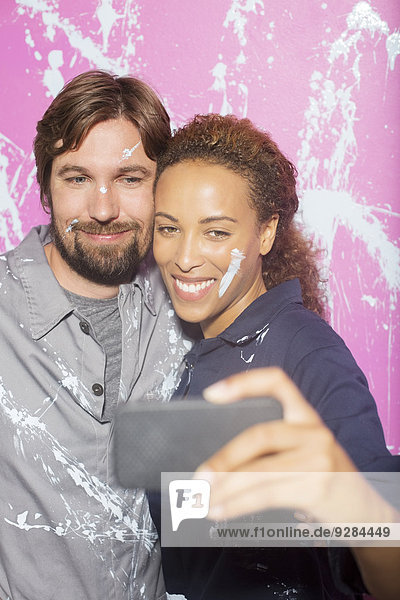 Couple taking picture together on cell phone