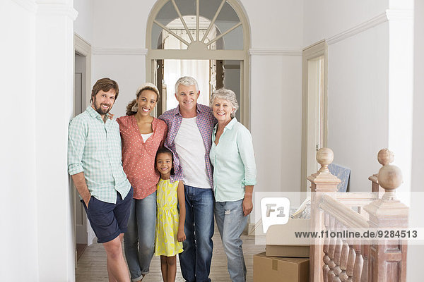 Family smiling together in living space