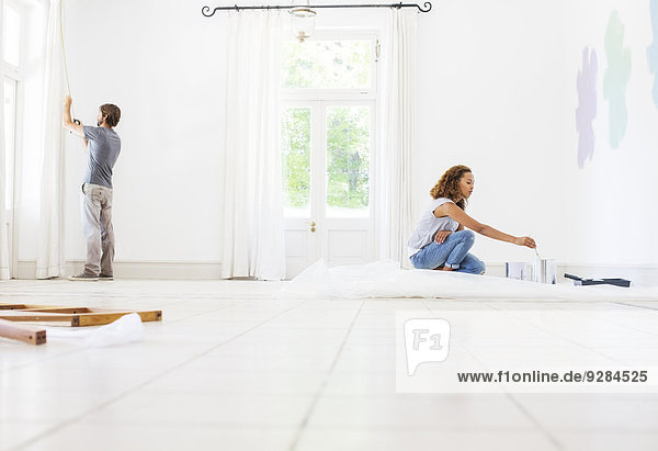 Couple fixing up new home