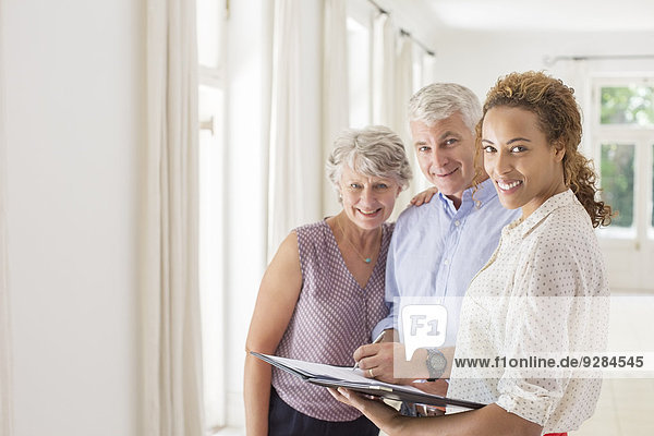 Older couple and woman signing documents