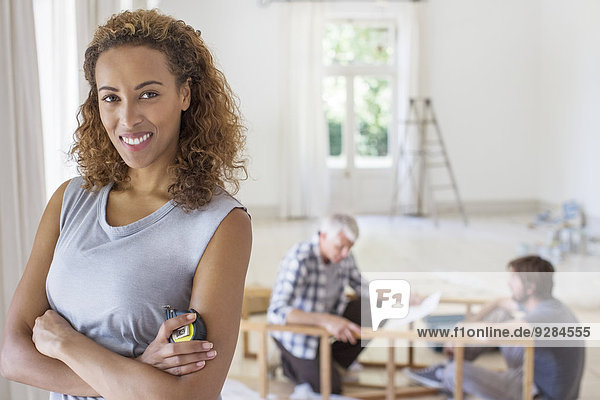 Woman smiling in living space in family working
