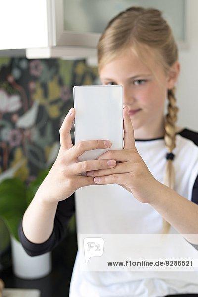 Fotografie nehmen Mädchen Smartphone