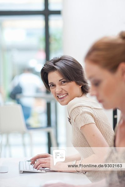 Female office worker using computer