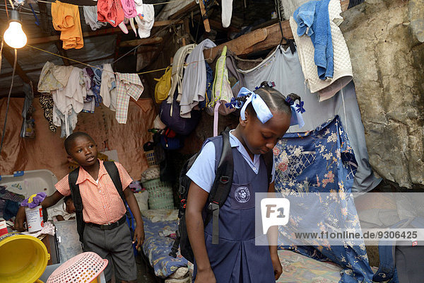 Brother and sister in school uniforms  Camp Icare for earthquake refugees  Fort National  Port-au-Prince  Haiti