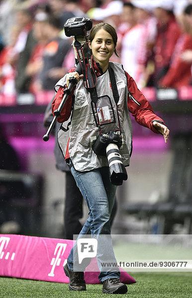 Female press photographer  sports photographer  Allianz Arena  Munich  Bavaria  Germany