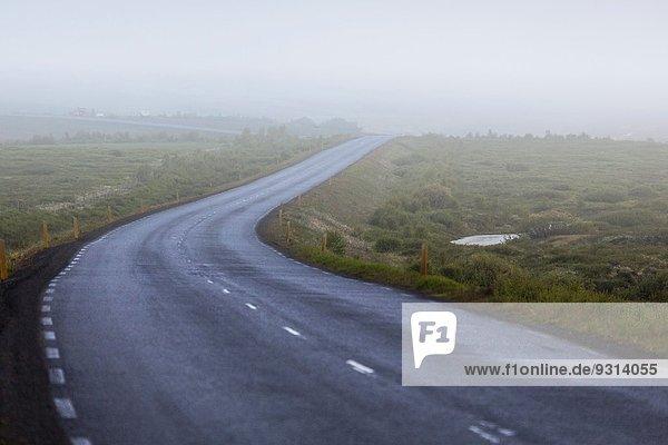 Foggy over road  Vikurskard passage  Northern Iceland.