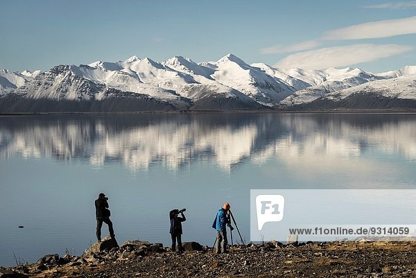 Photographers photographing the landscape  Hvalsnes  Eastern  Iceland.