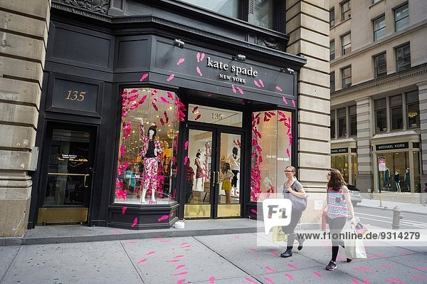 A Kate Spade store on Fifth Avenue  decorated in pink two and three dimensional high heel shoes  in the Flatiron neighborhood of New York. Kate Spade is owned by Fifth & Pacific  formerly Liz Claiborne