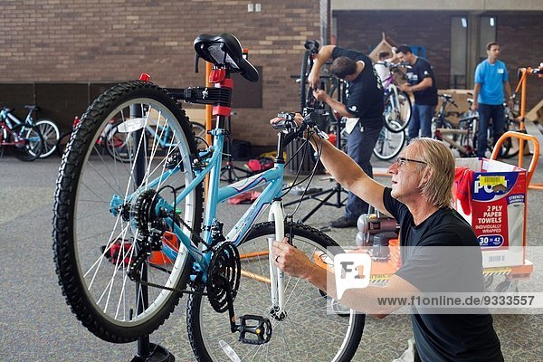 Southfield  Michigan - Volunteers assemble new bicycles for children. The bicycles were distributed to children in foster care or otherwise at risk by Orchards Children's Services  a nonprofit child welfare agency.