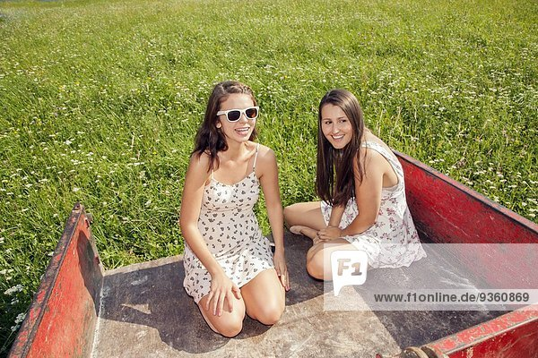 Young women sitting in trailer