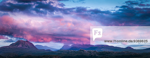 Panoramic view of pink clouds over remote landscape