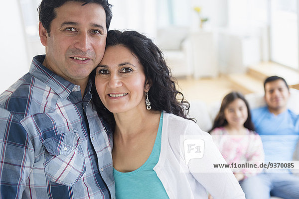 Hispanic family smiling together