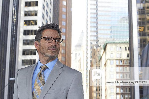 Caucasian businessman standing in city  New York City  New York  United States