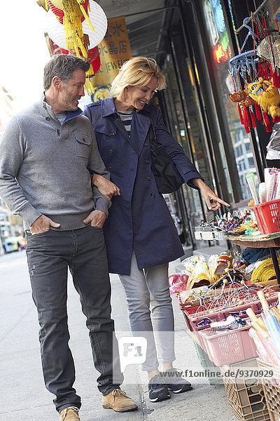 Caucasian couple shopping in Chinatown  New York City  New York  United States