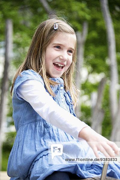 Happy girl in the playground  Munich  Bavaria  Germany