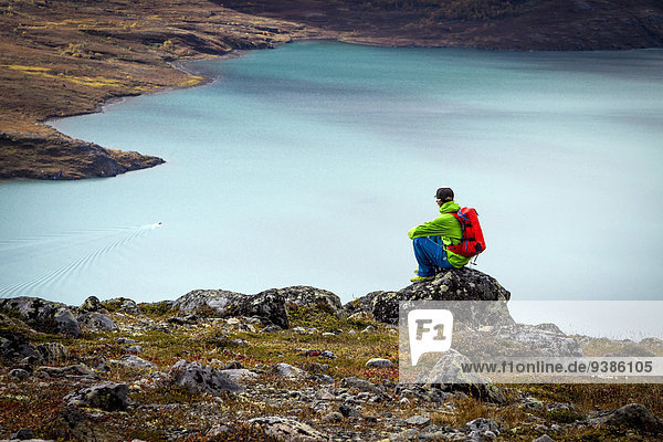 Hiker taking a rest a fjord  Norway  Europe