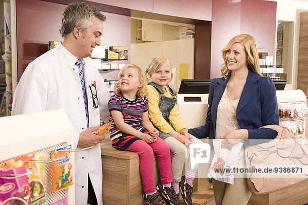 Mother With Children In Pharmacy  Munich  Bavaria  Germany